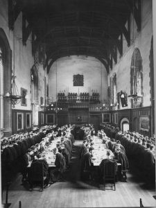 The Great Hall in 1960, with students dining in tradition gowns